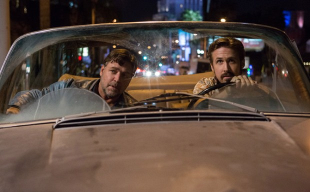 "This image released by Warner Bros. Entertainment shows Ryan Gosling, right, and Russell Crowe in a scene from ""The Nice Guys."" (Daniel McFadden/Warner Bros. Entertainment via AP) ORG XMIT: NYET943"